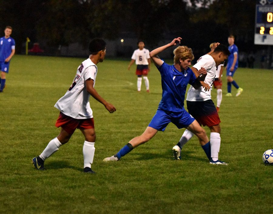 Senior Jack Hanson lunges for a ball