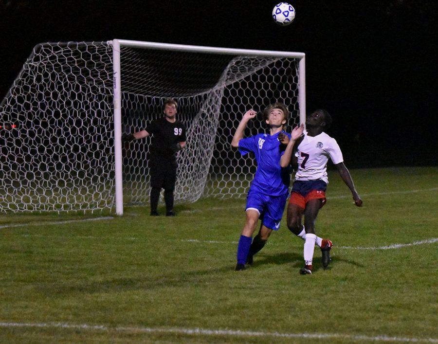 Sophomore Aaron Bangs looks for the ball against an Albert Lea Forward