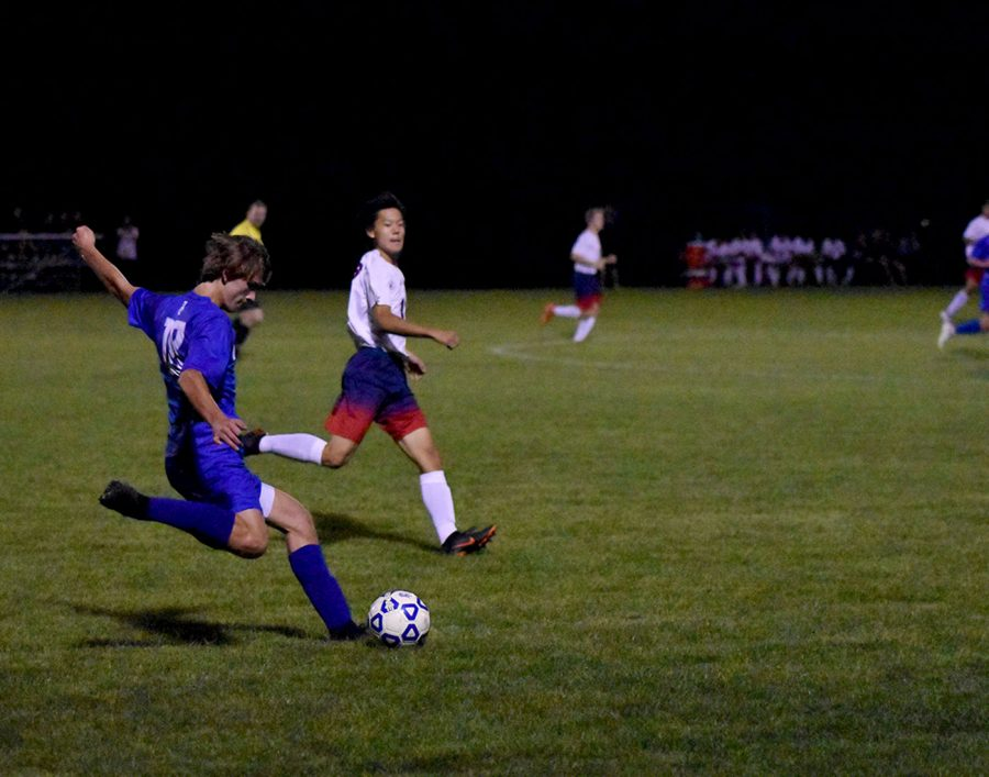 Sophomore Aaron Bangs loads up for a kick downfield