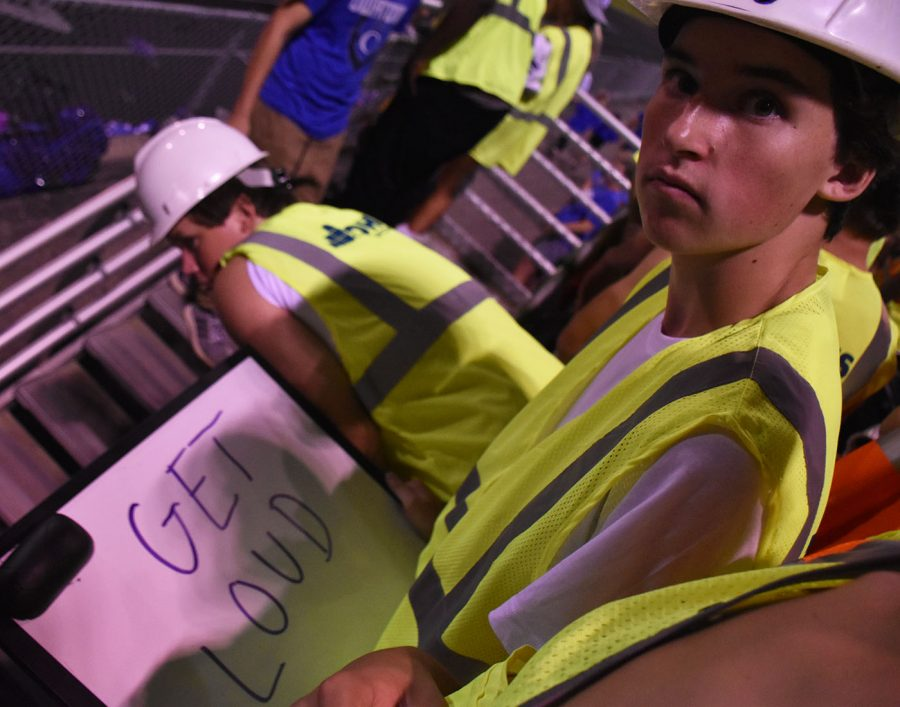 Senior student section leader prepares to run the next chant