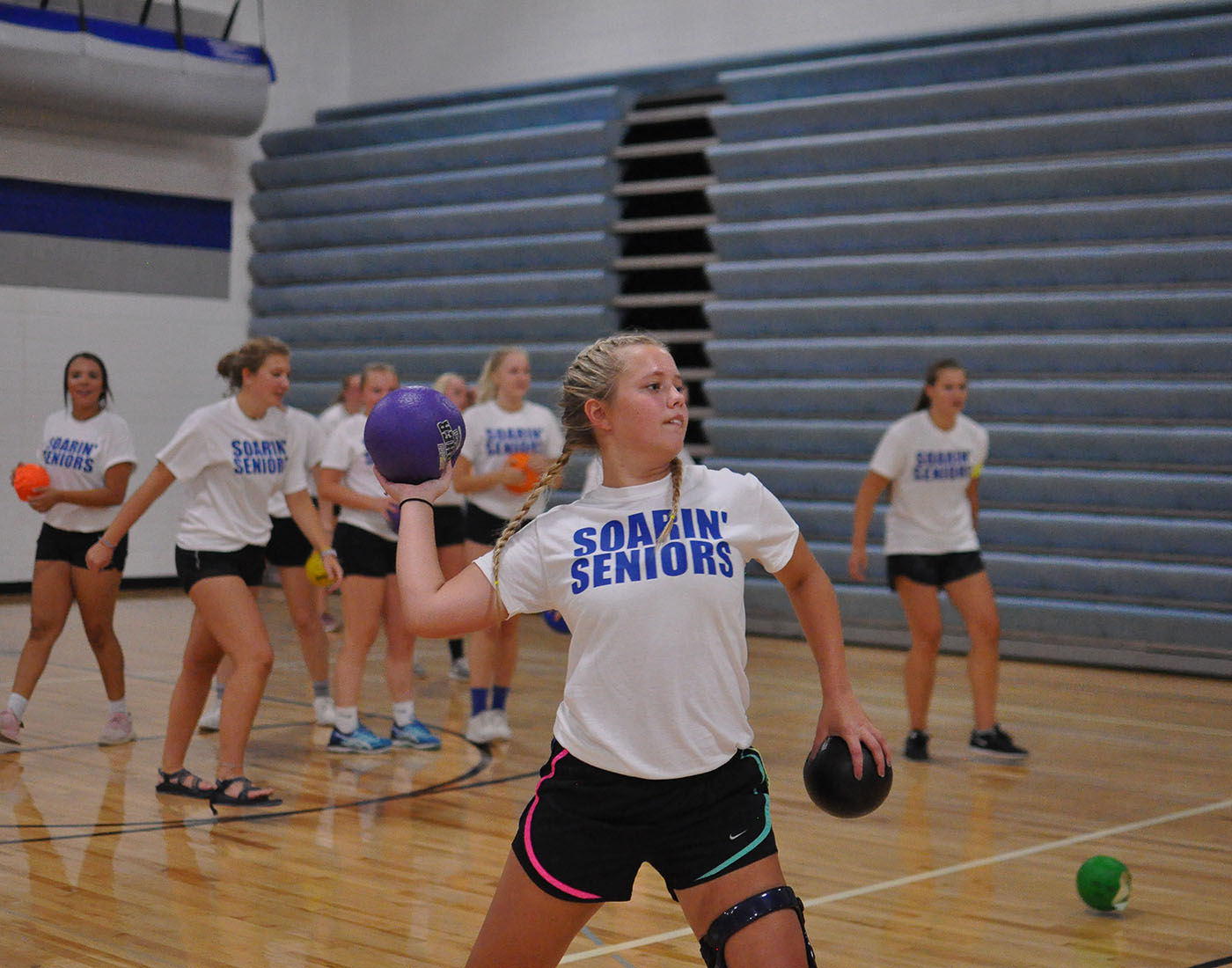 Senior+Cassondra+Bremer+loads+her+arm+back+for+a+throw+at+the+opposing+team