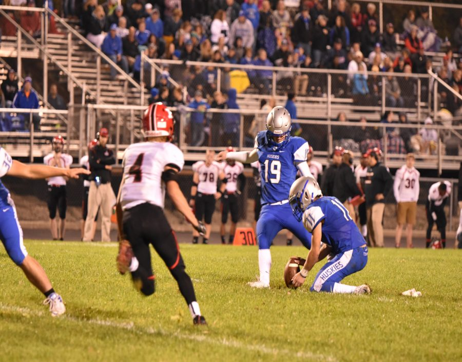 Senior Ben Zappa hold for Senior David Keller's kick