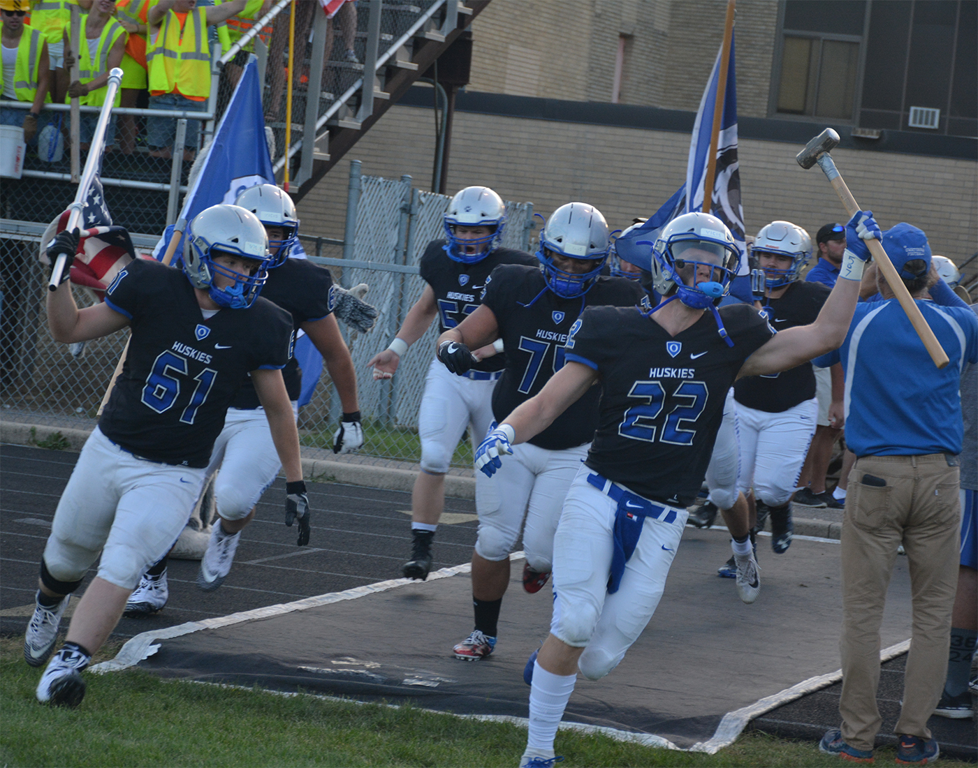 OHS Huskies run out onto the field