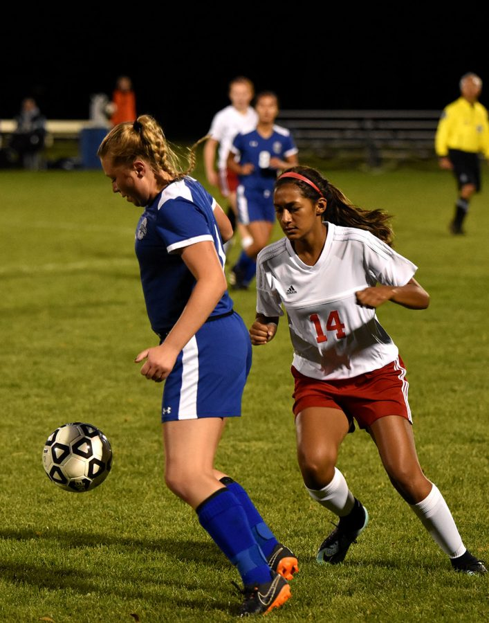 Kiley Friedrichs pushes the ball in front of her