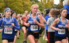 Girls cross country races to the finish