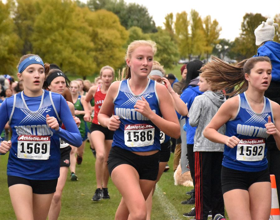 Liv+Larson+races+with+the+Owatonna+Cross+Country+team+at+Ev+Berg