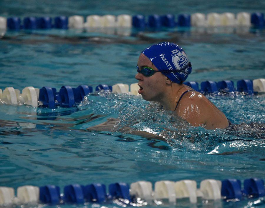 Owatonnas Swimmer hustling till the end of her race