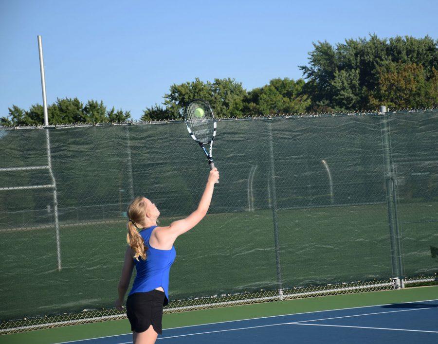 Maggie Krumholz serves the ball