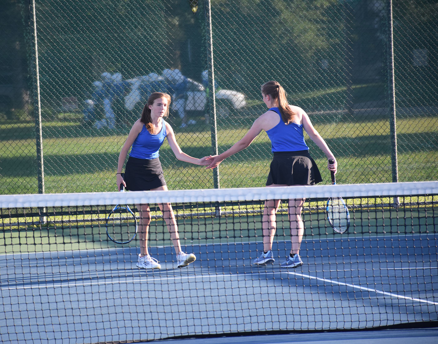 Cora Barrett and Lauren Thamert congratulate each other after a match