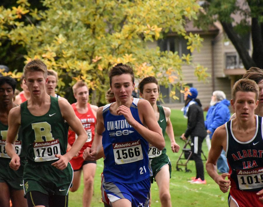 Owatonna pushing forward against its opponents in boys Cross Country