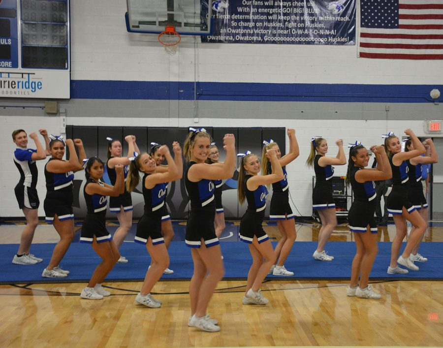 Cheerleaders in the middle of their dance