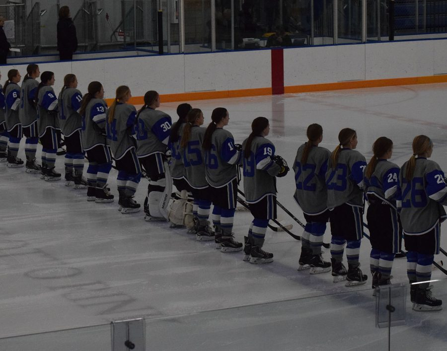 OHS Girls Hockey team stands for the National Anthem