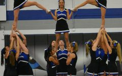Cheerleaders stunting at the pepfest