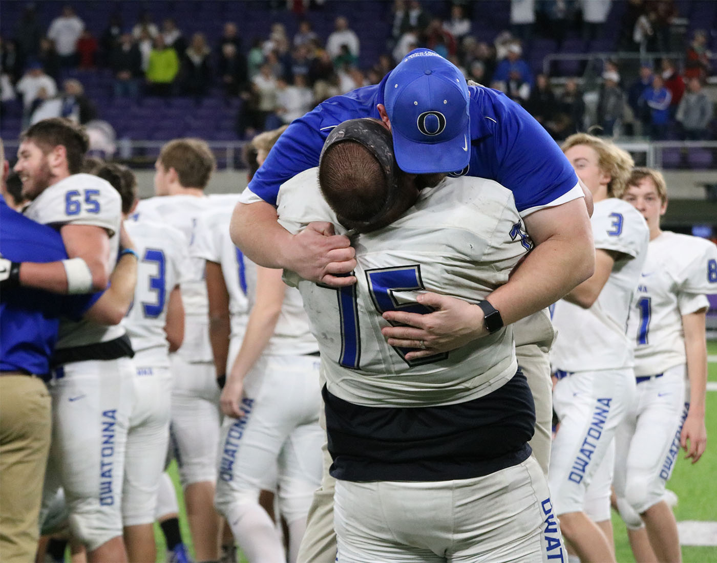 Chris Lewis lifts up Coach Johnson in celebration after the title game. Lewis will appear at the All-State Game on Saturday, Dec. 15
