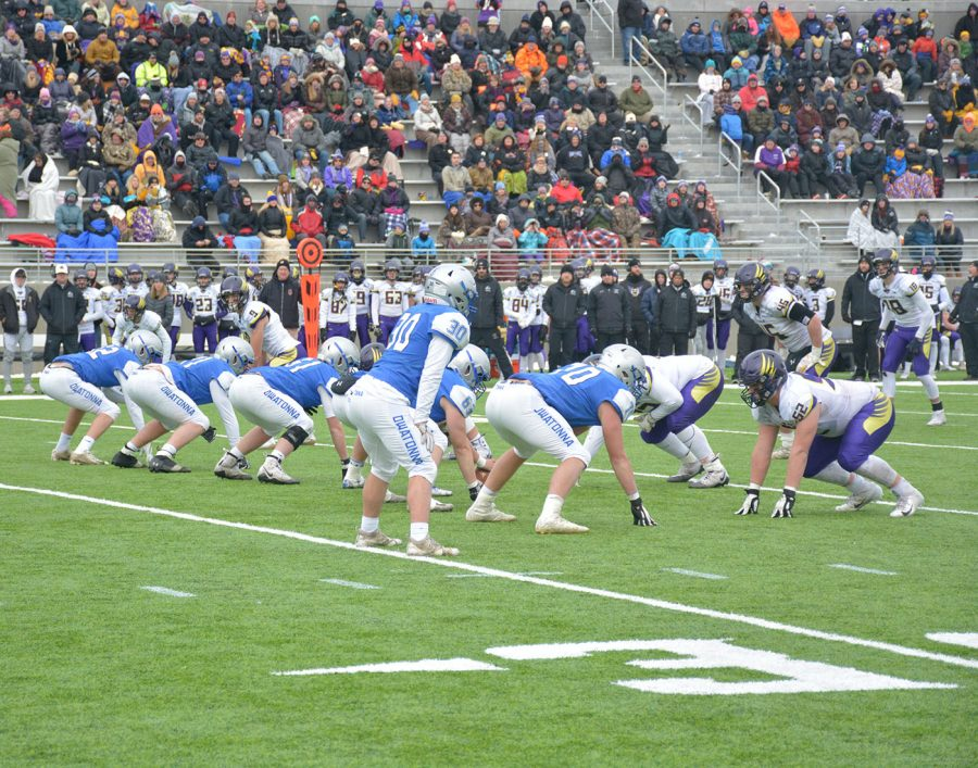 Owatonna blue collar lines up against Charkas defense