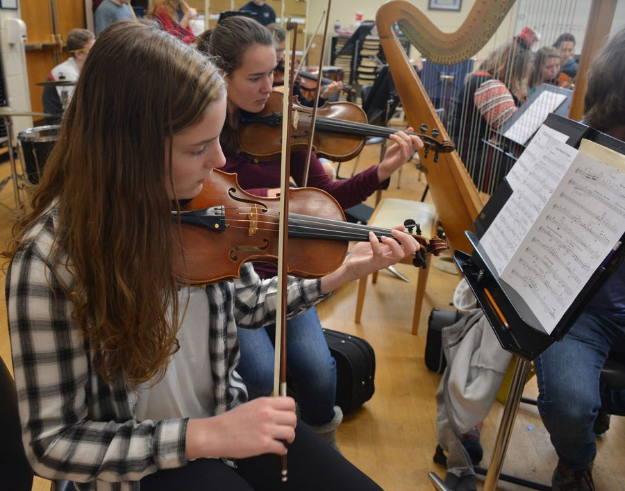 Orchestra members practicing during class
