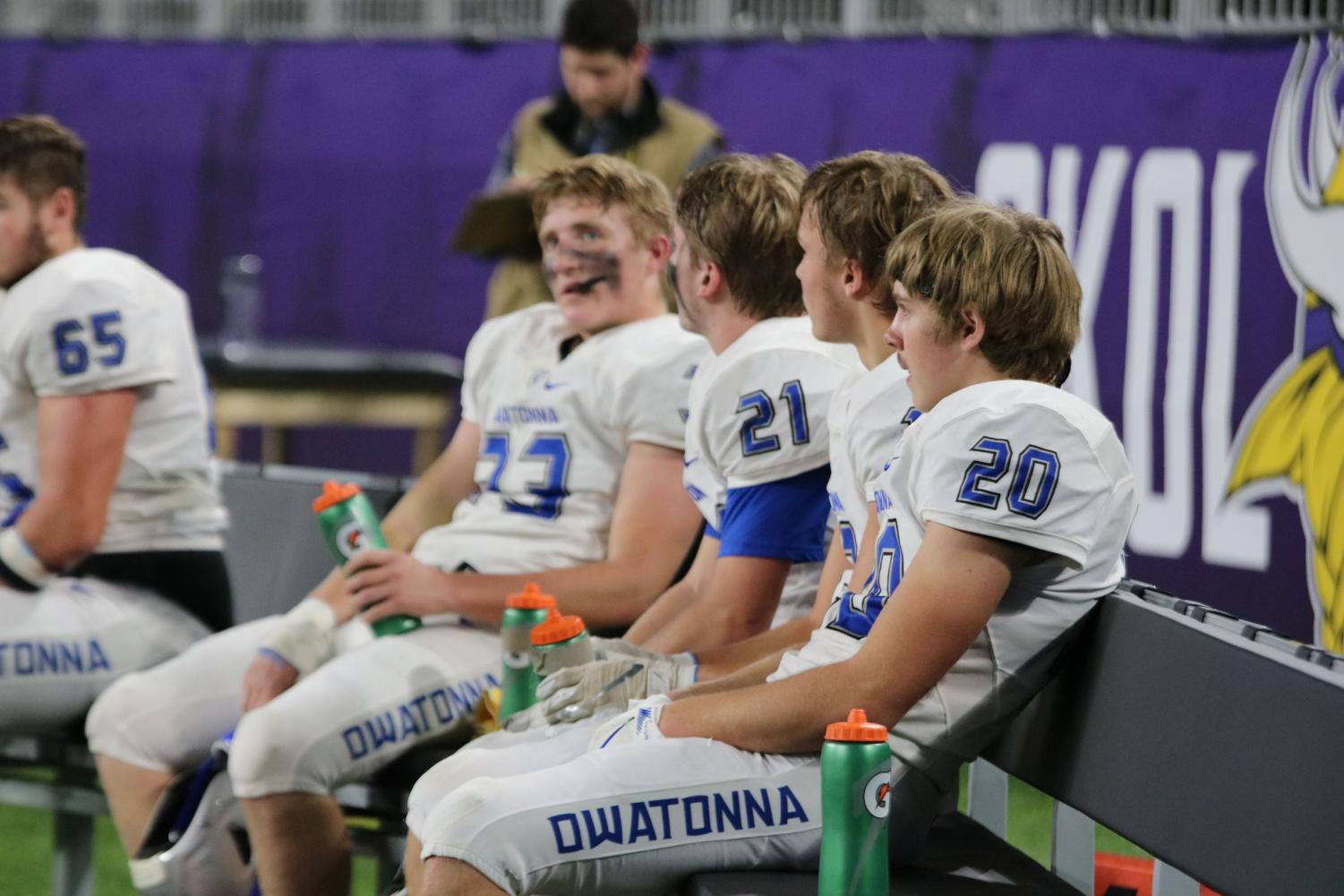 Players+of+the+Owatonna+defense+sit+and+wait+for+the+offense+to+score