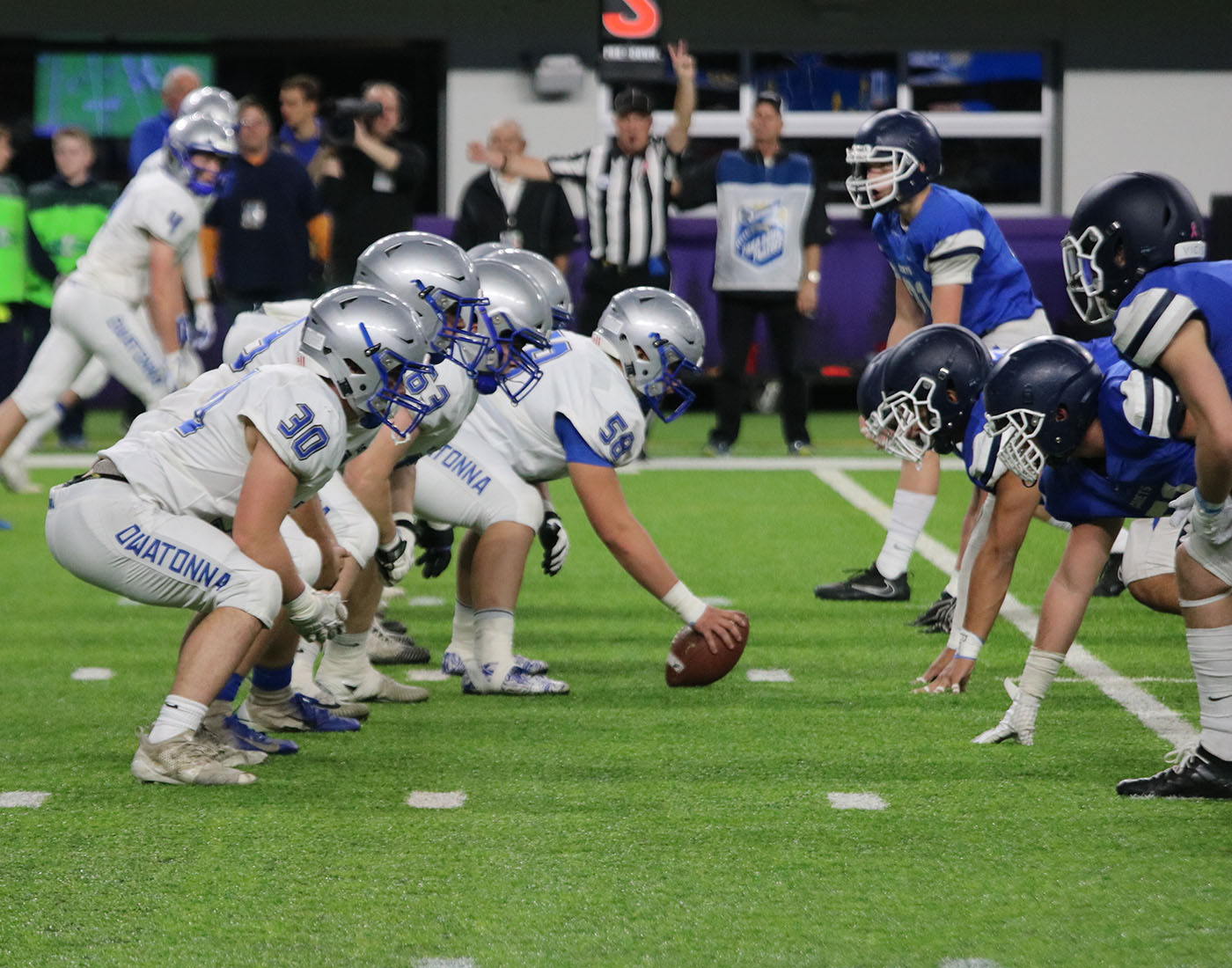 Owatonna+blue+collar+lines+up+pre-snap