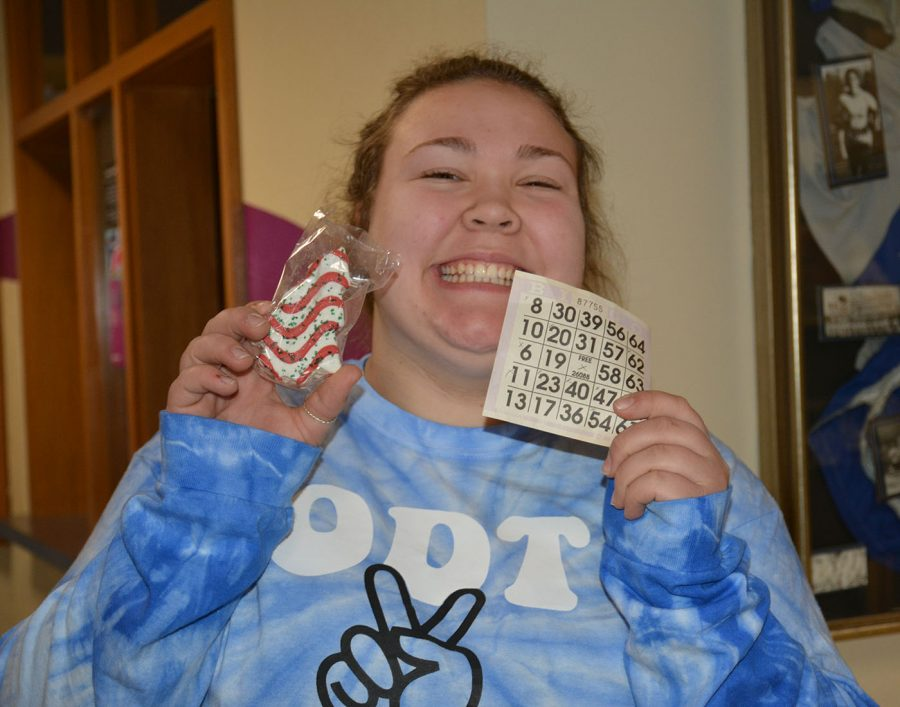 Hailey+Rysavy+smiling+with+her+winning+card