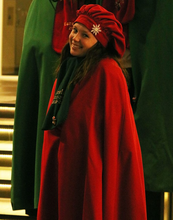 Taylor Woltman possessing in her Caroler robe.