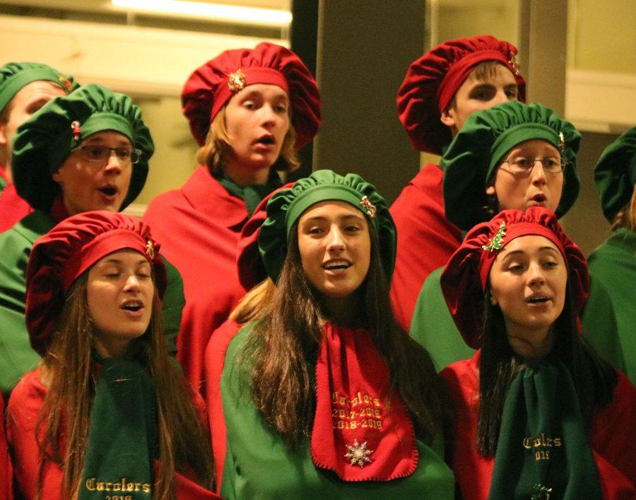 Carolers singing passionately.