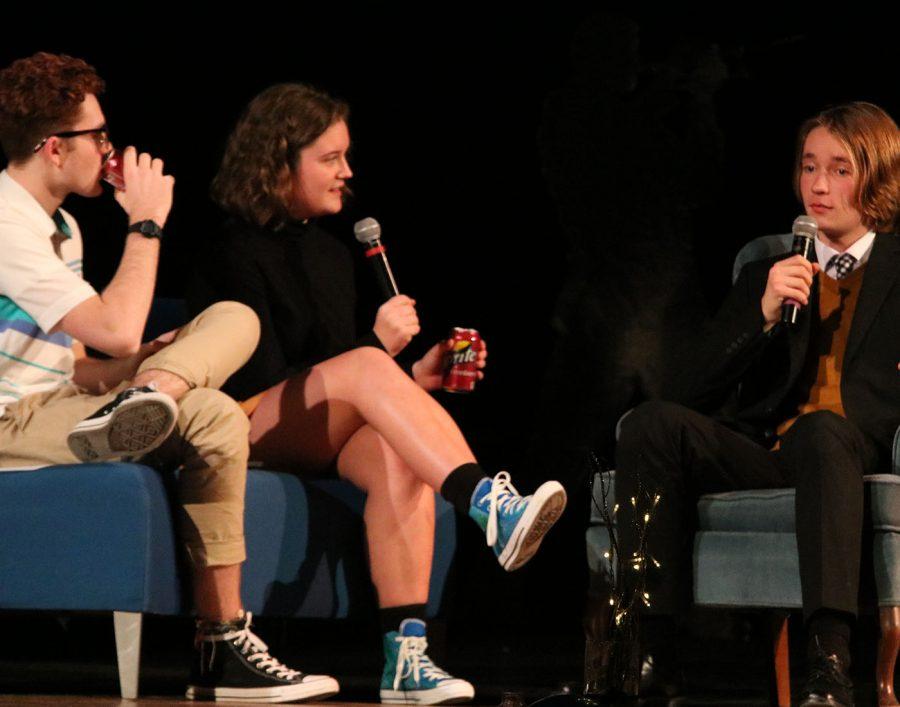 Student council members Lauren Arthur and Matthew Buetel talk to Nathan Buegler
