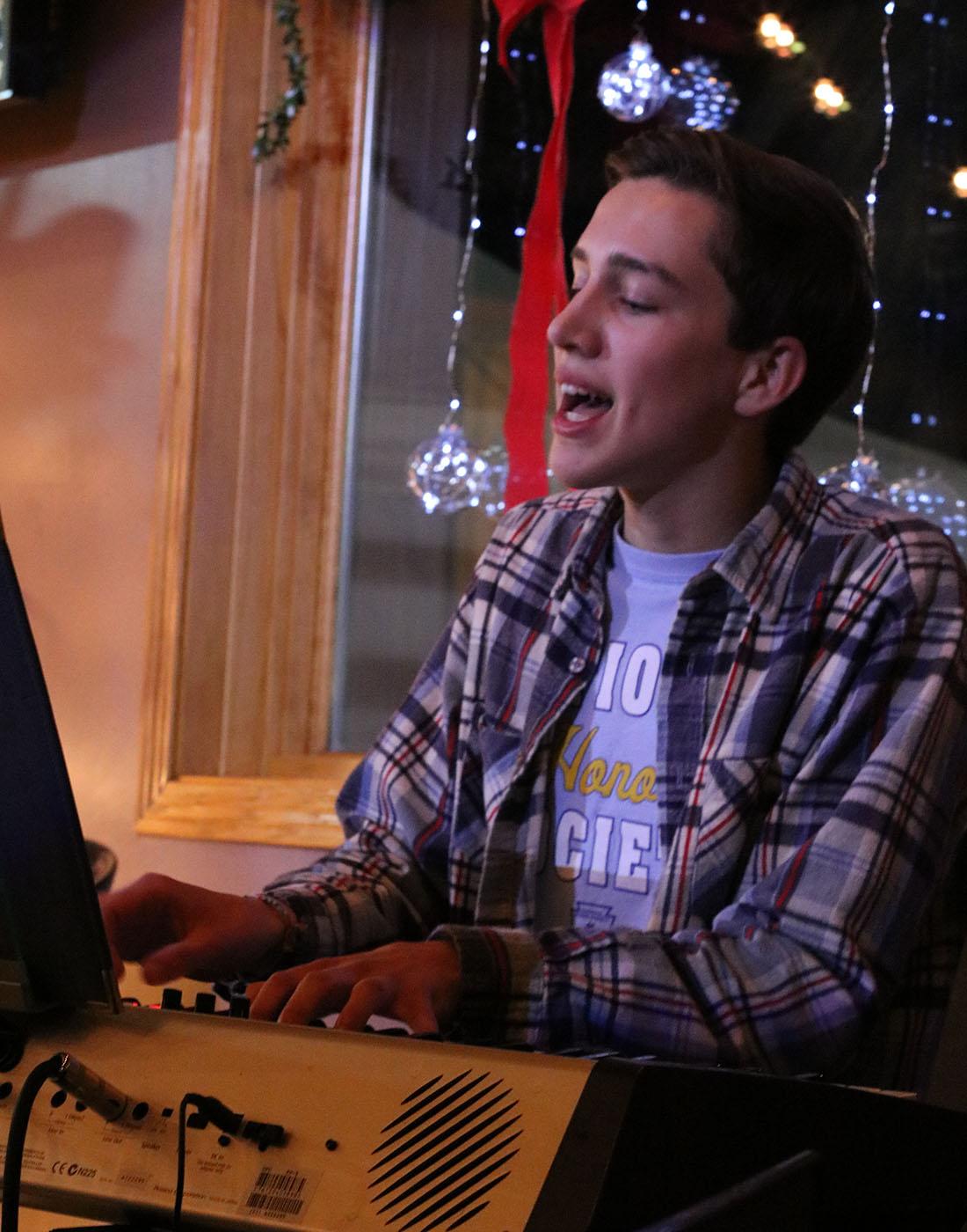 Gabriel Rysavy plays the keyboard and sings at the Art Splash
