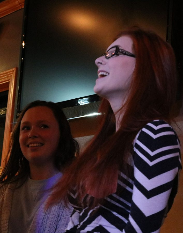 Ariana Wilker and Taylor Woltman sing a duet during the Art Splash