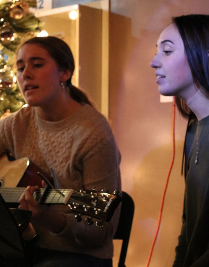Kaia Elstad and Maggie Marks sing a duet at the Art Splash