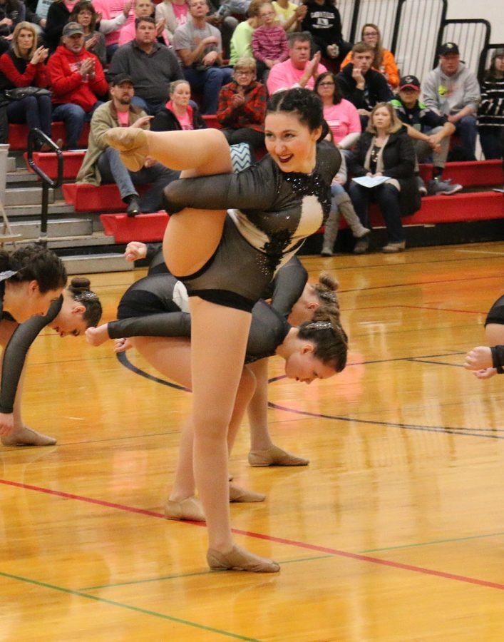Emma Anderson hits a final pose in the varsity jazz dance