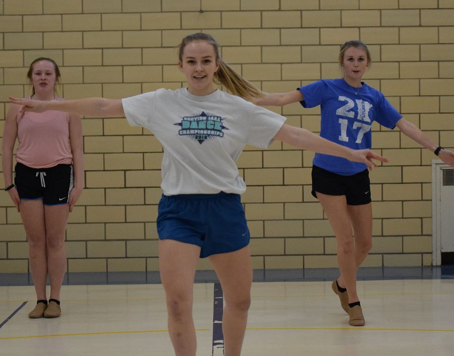Brianna Bailey, Morgan Blood and Elizabeth Fisher dance during practice