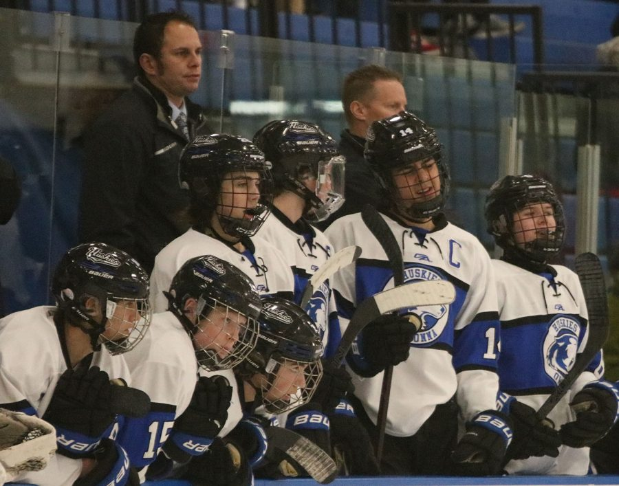 The bench watches the game