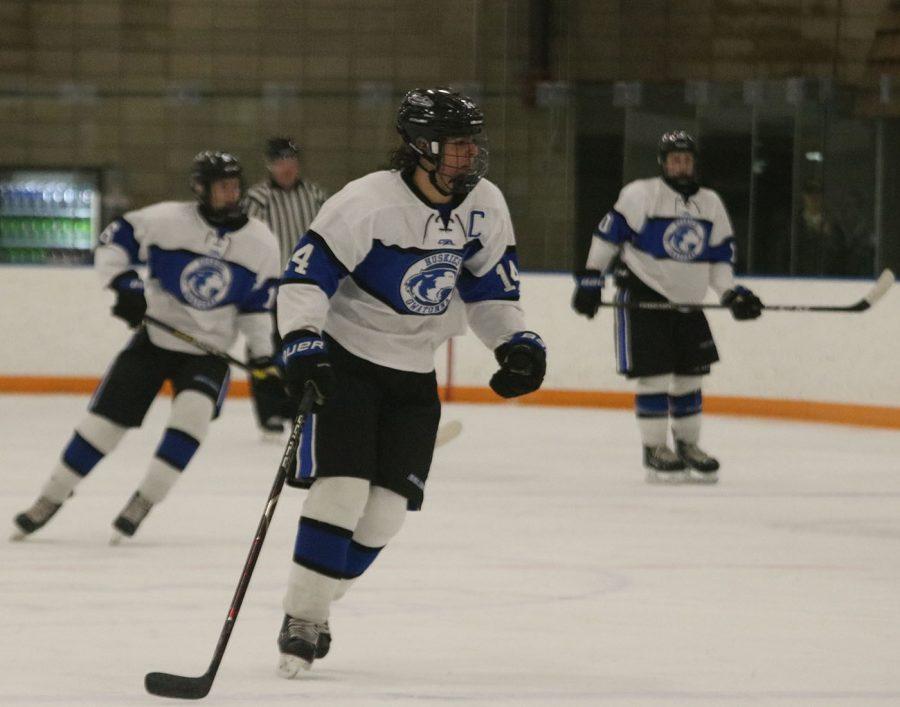 Senior captain Luke Kubicek skates to the puck