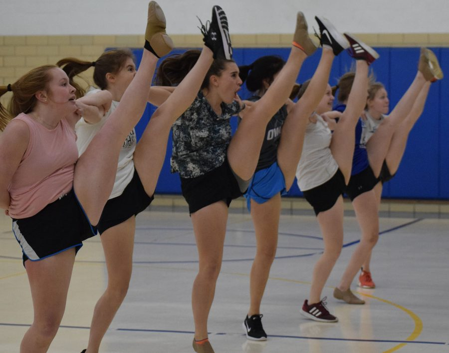 The team practices their kick line during practice