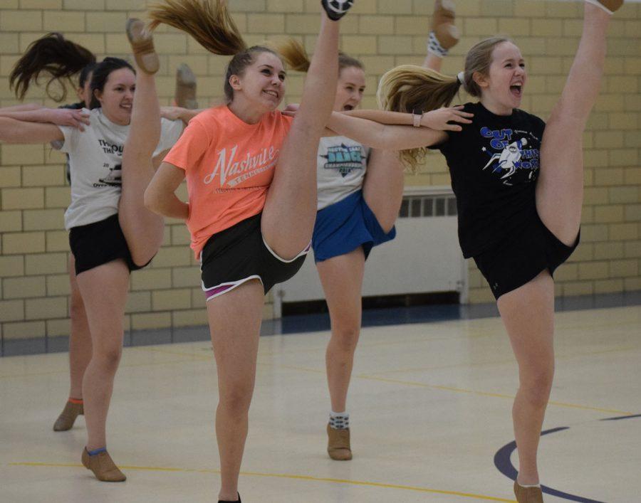 Girls practice their kicks