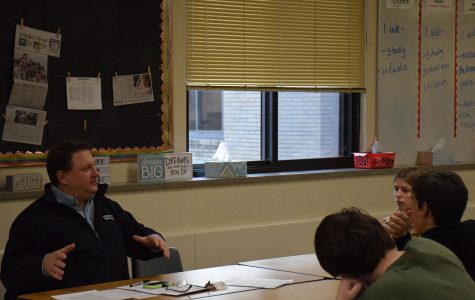 Mr. Bill Lawrence speaking with Culinary Club members
