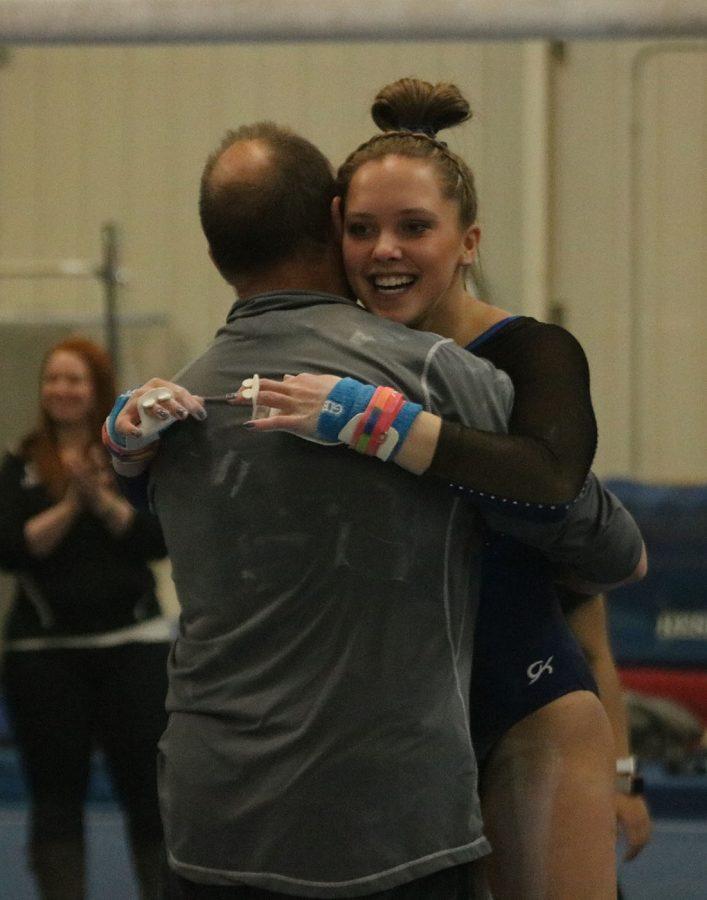 Lindsay Bangs hugs her coach
