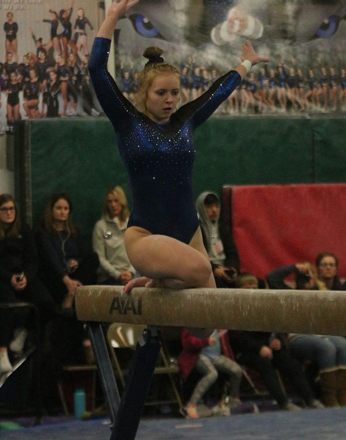 Grace Barner begins her beam routine