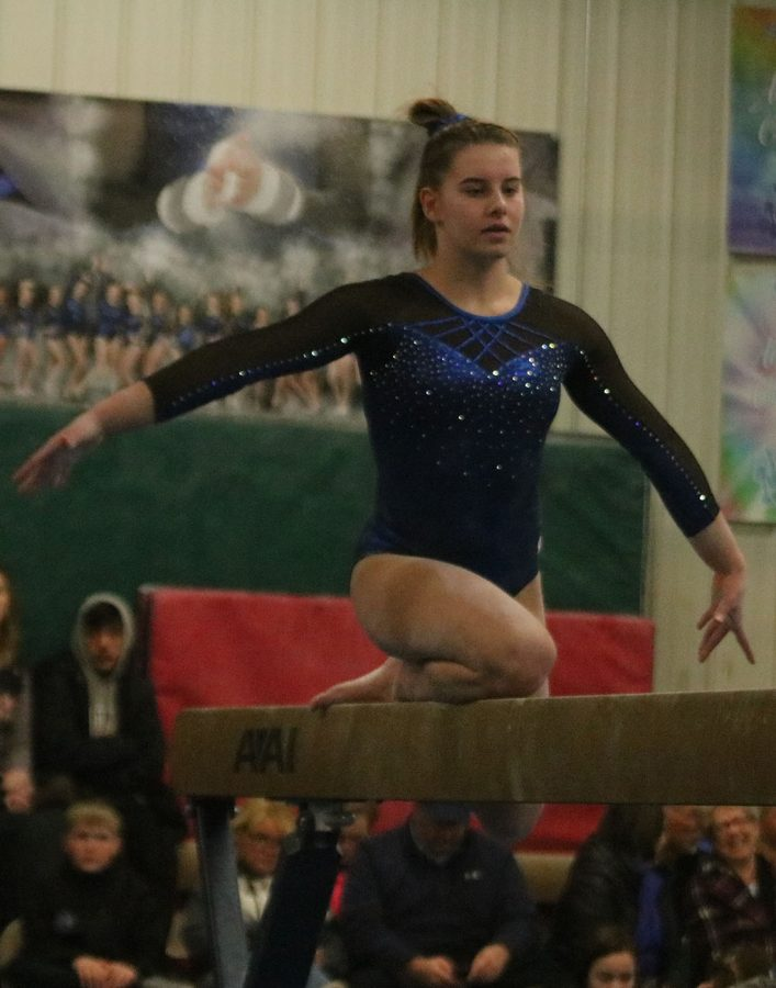 Lucy Macius performs her beam routine
