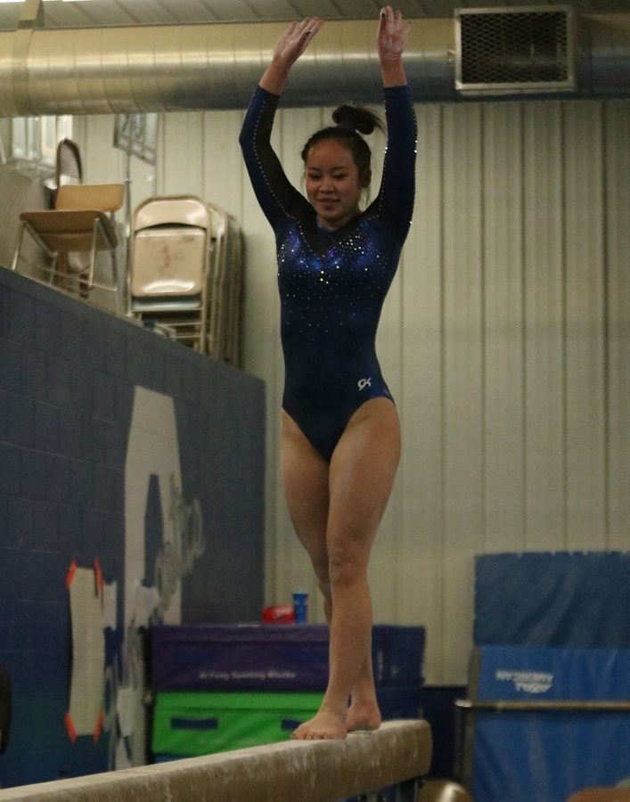 Allison An performs her beam routine