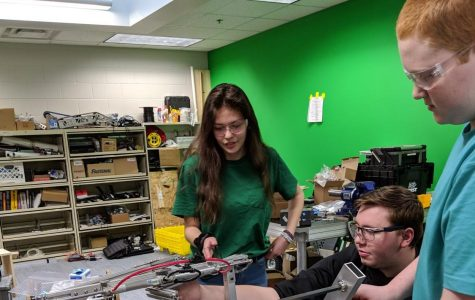 The only female robotics team member Elena Alba works on the robot for the upcoming invitational