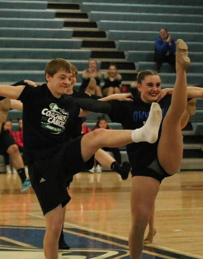 Jaden Dallenbach and Elise Sande kick during the boy-girl dance
