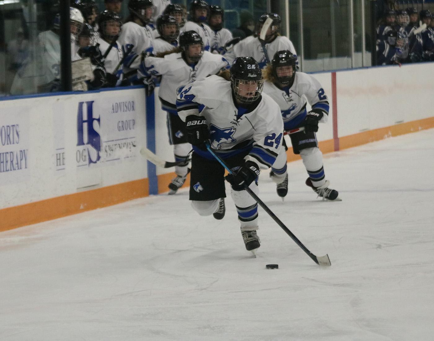 Freshman Abby Vetsch skates down the ice