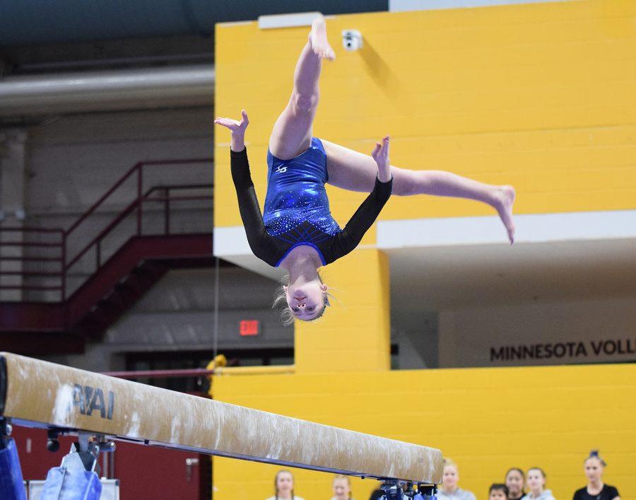 Eighth grader Cheyenne Petersen preforms her beam routine