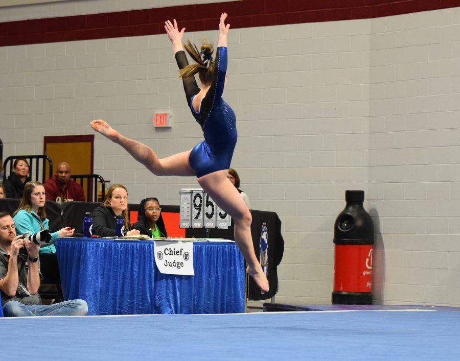 Sophomore Lindsay Bangs preforms her floor routine