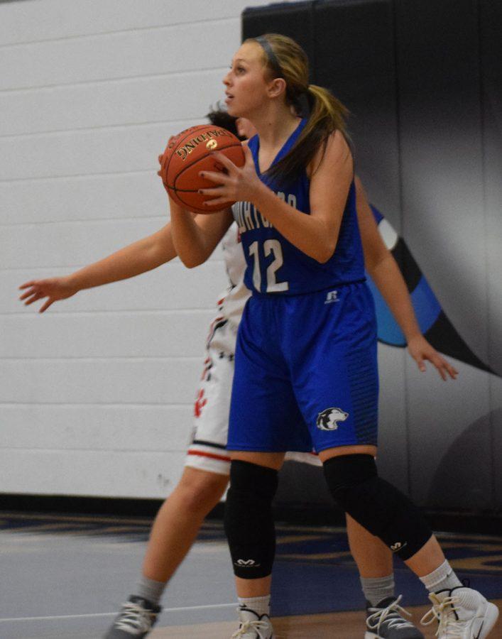 McKenna Schroht looks for the pass