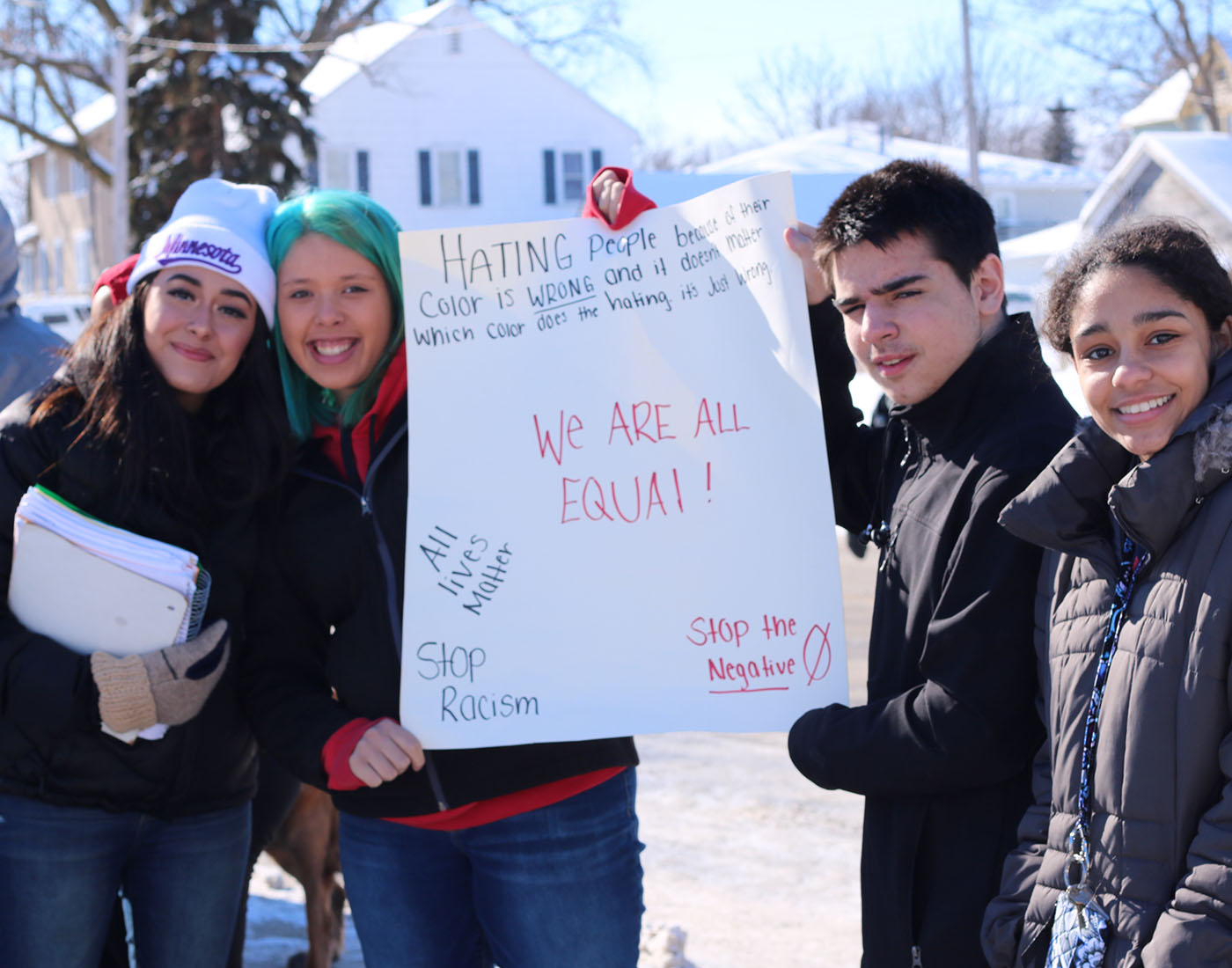 Students holding a poster