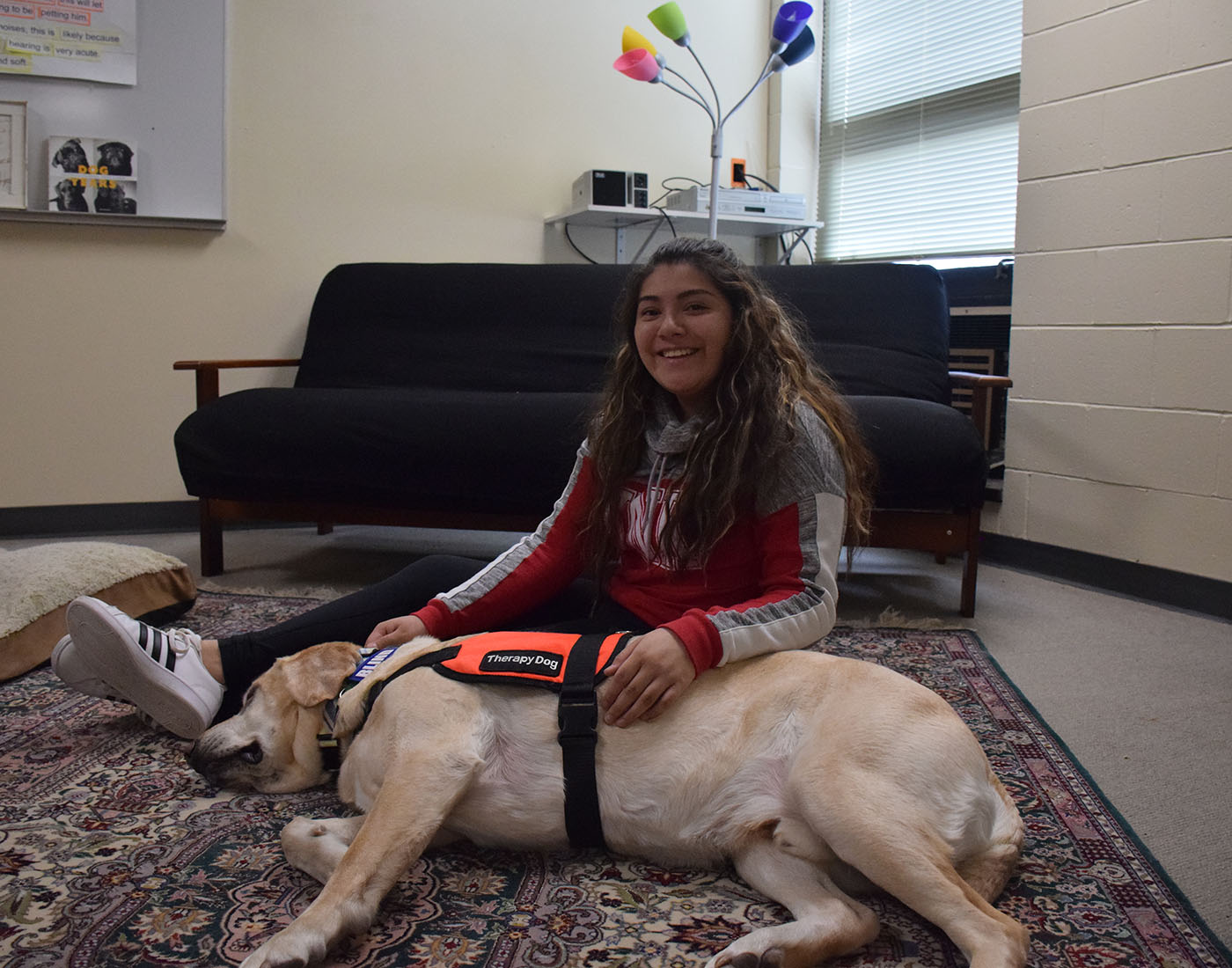 """Freshman Nena Zamarron said, """"It helps me relieve and calm down if I am having a bad day. Petting and looking at the dog helps me relax."""""""