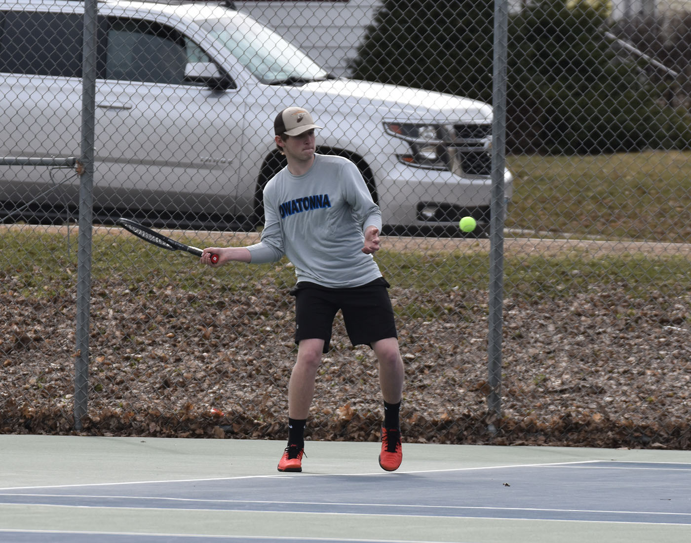 Senior captain Cody Bussert hits a forehand during his match