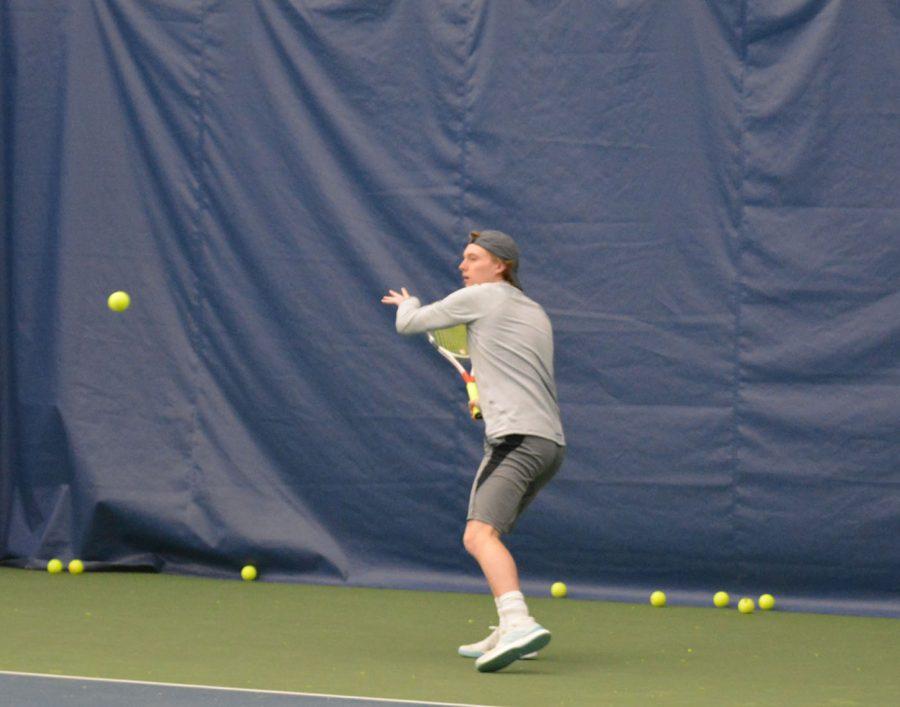 Junior Evan Huemoeller practices at West Hills
